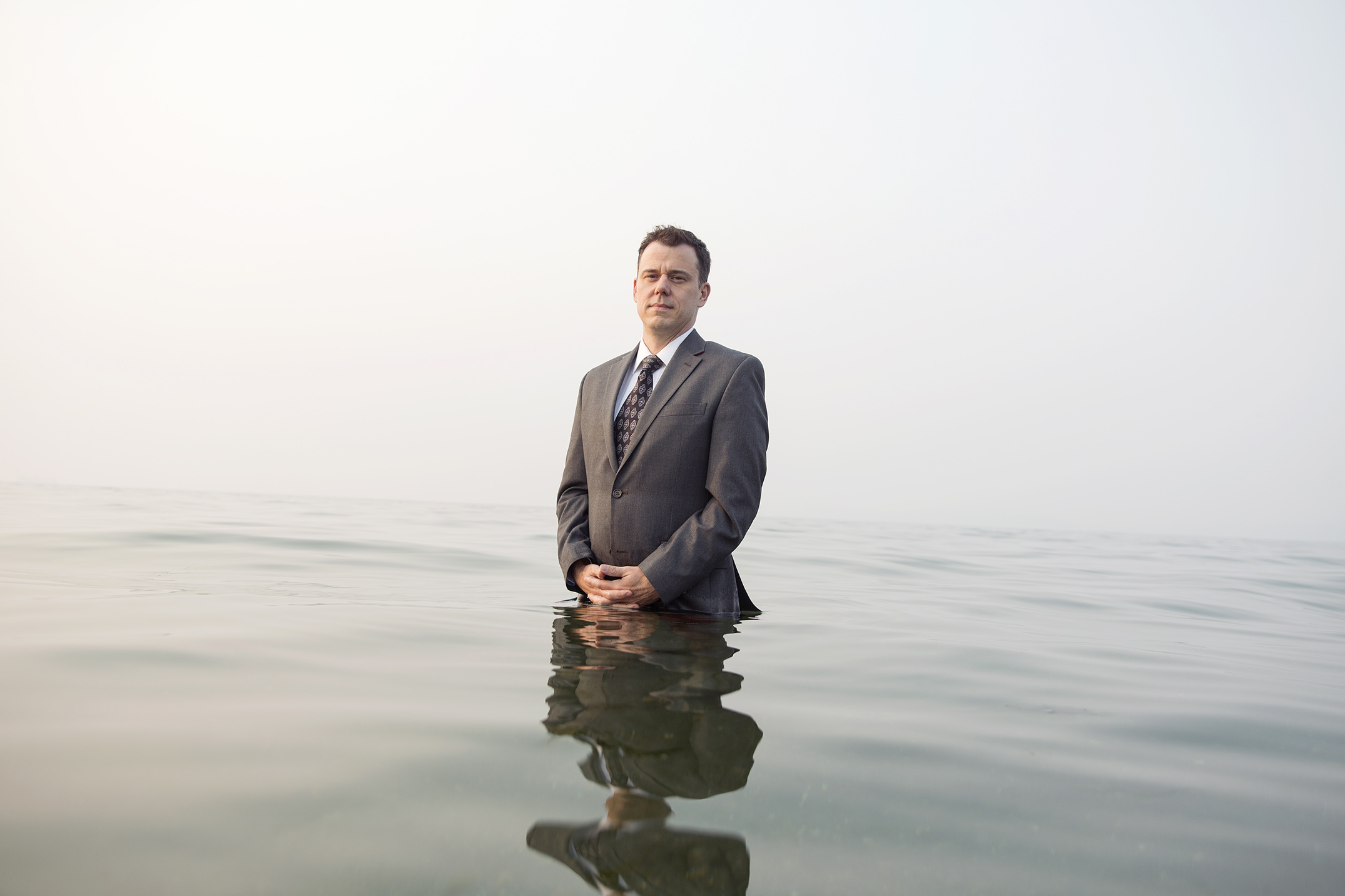 Mike Kane | Funeral director half-submerged in Puget Sound | Seattle documentary, editorial, and commercial photography